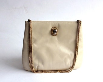 cream leather purse . 1970s purse with gold cougar head . vintage chain strap purse . white leather pouch purse Ruth Saltz handbag