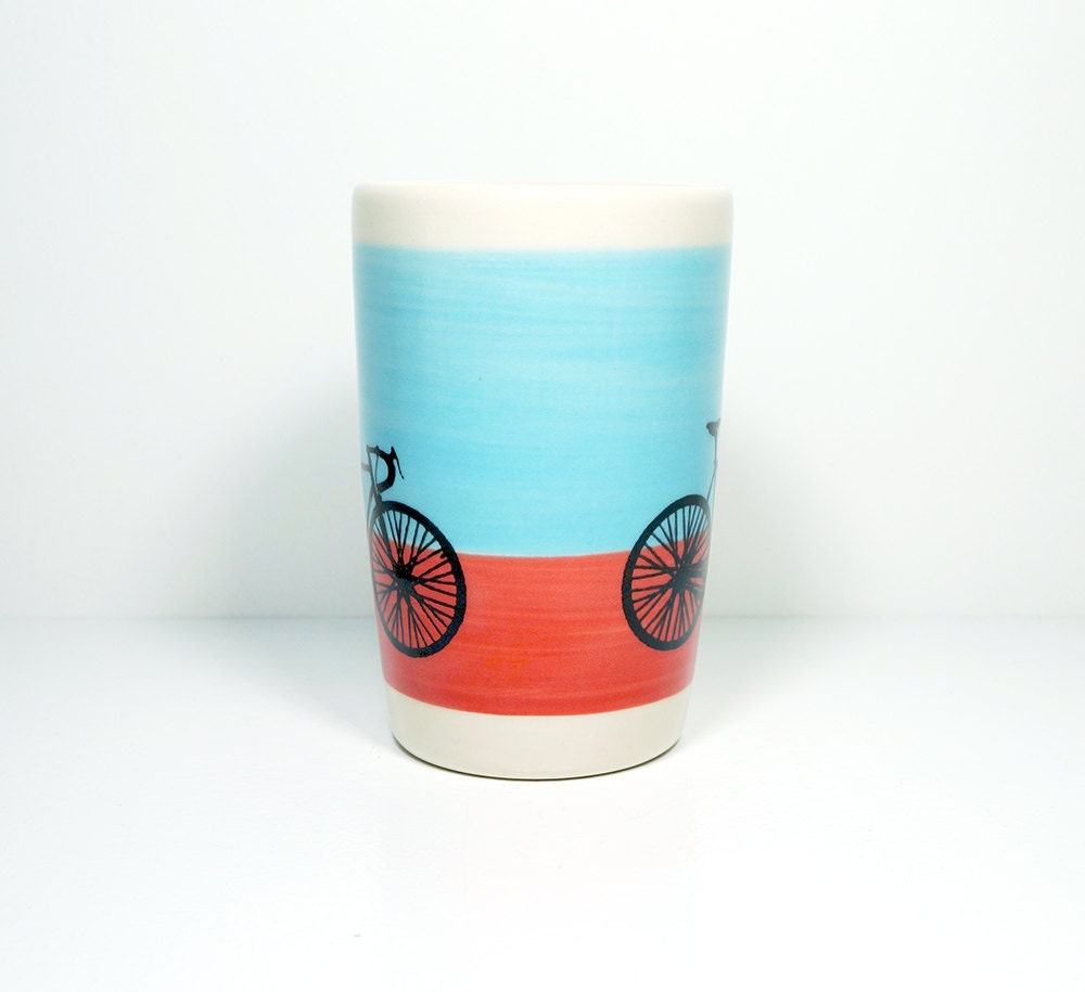 18oz tumbler with a road bike on a color block of sky blue and red-orange. Made to Order.