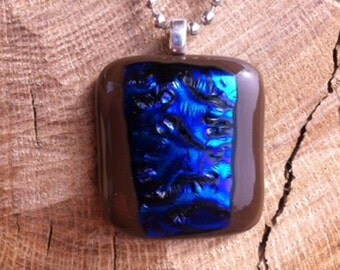 Chocolate Brown Fused Glass Pendant With Blue and Purple Metallic Dichroic Strip