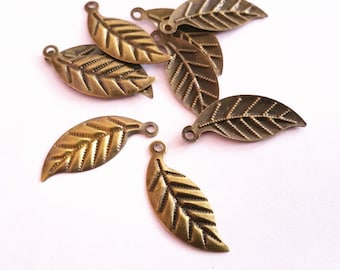 33pc 24x10mm antique bronze finish leaf shape filigree charms-9712