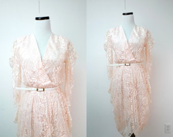 WONDERFUL TONIGHT . vintage peach lace dress . fits a small to medium . made in USA