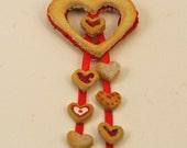 12th scale handmade miniature hanging shortbread heart.