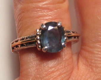 Lovely Dark Tealy Blue Sapphire Sterling Silver and 14 kt Gold ring .Victorian Antique Style  . size 7   .. e720