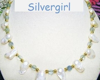 Shimmering White Freshwater Pearl in the Wonky Shell Necklace