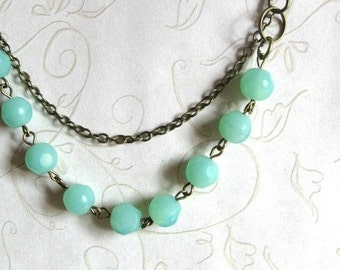 Mint green necklace – vintage inspired necklace, faceted beads, brass leaff charm