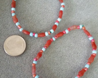 2 Blue and red stretchy fish bracelets.
