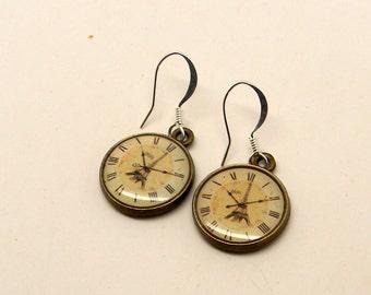 Steampunk clock earrings.