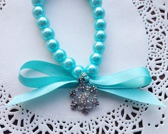 Frozen snowflake - Pearl bead, ribbon and charm bracelet - Elsa blue