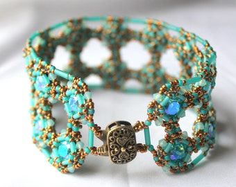 Hand Beaded Bracelet with Swarovski Light Turquoise Gracier Blue Chatons, with Matte Tr Teal bugles and seed beads, accented with bronze.