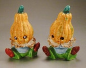 PUMPKINS PEOPLE  Salt and Pepper Vintage signed Japan  3  in tall 2  in diam yellow  blue green