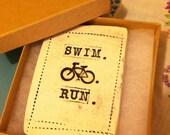 Triathlon tile magnet