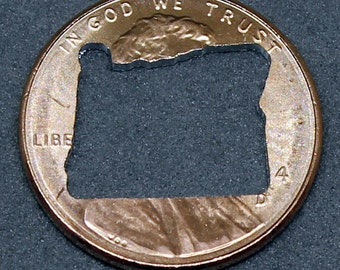 Lucky penny with Oregon cut out