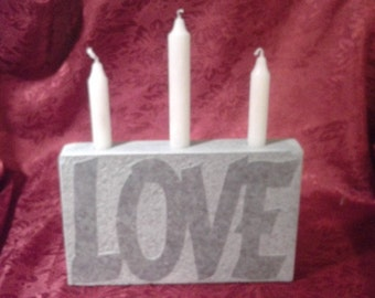 "Handmade soapstone candle holder with ""LOVE"" engraved in one side."