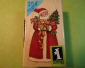 Inkadinkado - Santa Wood Rubber Stamp  Santa with arms full of toys, tree and presents