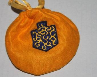 dreidle bag with dreidle game instructiions