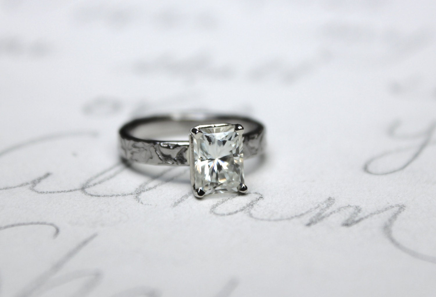 moissanite engagement ring unique emerald cut by peacesofindigo