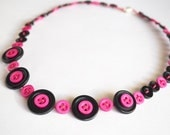 Pink on black button necklace handmade with recycled buttons.