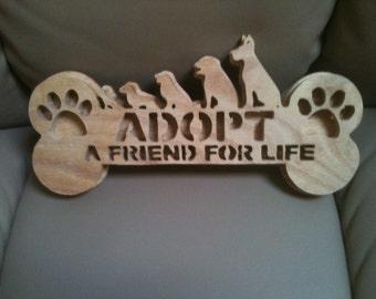 Wooden adopt a friend wall hanging