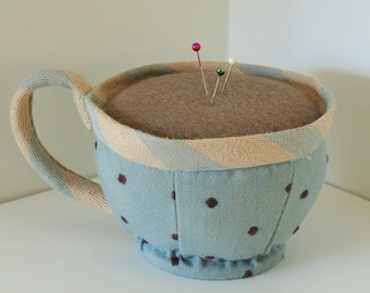 Fabric tea cup pin cushion