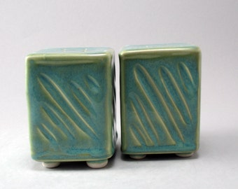 Porcelain Salt and Pepper Shakers Finished in a Pearl Green Glaze with Carved Texture on the Sides with Rubber Stoppers in the Bottom