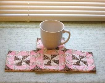 pink and brown set of mug rugs
