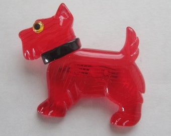 A Translucent Red Scottie Dog Standing Lucite Pin / Brooch.