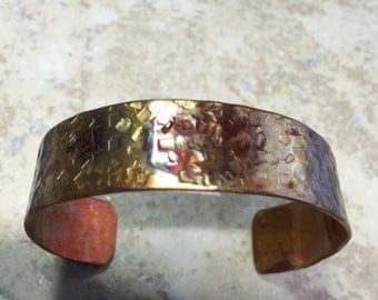 Heat patina hammered copper cuff - fits 5.75 inch wrist.  Free shipping to US locations, reduced rates  to all other countries.