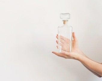 r e s e r v e d mid century glass decanter . clear rectangle bottle and topper .sale