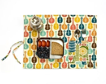 Groovy girl placemat with ukelele, guitars and VW vans. Organic place mat 70s for her in orange, blue and yellow.