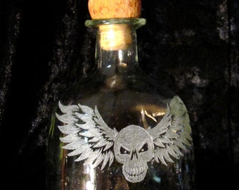 Winged Skull Recycled Patron Bottle