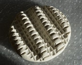 1 deeply textured polymer wet felting disc, perfect for felting wool.