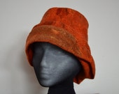 hand made Wet felted winer hat, merino wool and silk mawata, sculpted into a one of a kind burnt orange and tan hat