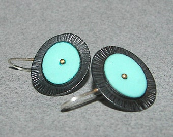 Turquoise enamel and burnished, hammered, patinated copper, sterling silver, and brass oval drop discs