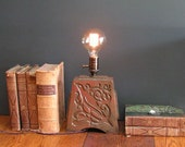Stoneware lamp with vintage Edison bulb, indented Art Nouveau design of a bird, with copper glaze
