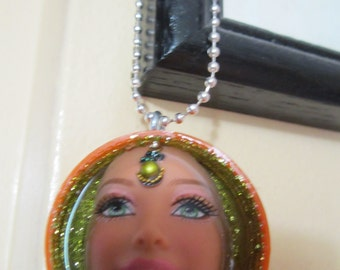 Barbie doll head. Altered art. Upcycled barbie. Necklace.