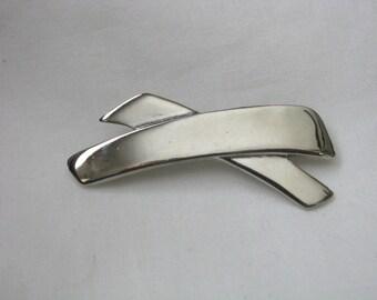 Unusual geometric silver tone stylized X shaped pin brooch