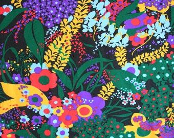Yardage of floral retro fabric. Stretchy knit fabric, jersey fabric, flower power fabric, jewel tone fabric, polyester fabric, funky fabric,