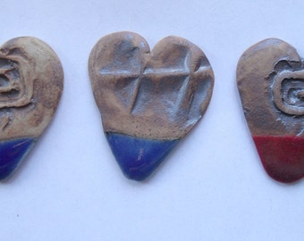 Heart shaped guitar pick- blue or red glazed tip, designed with spiral or lines