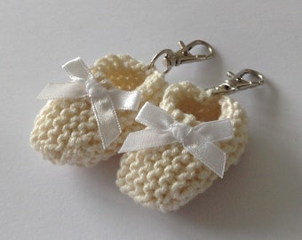 Baptism/ baby shower favors - hand knit ivory baby bootie on key ring with white bow - 2 inches - set of 2