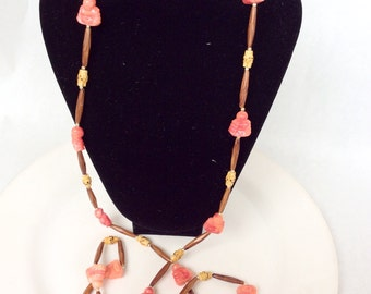 Long vintage necklace early plastic oriental design coral and wood color