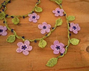 crochet necklace, lariat, lilac flower, green leaves