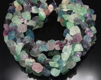 1strand - natural fluorite matt rough tumble sized about 15 by 18mm