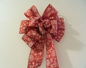 Christmas wreath/decorative bow red with white snowflakes