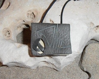 Signs- This small Wisdom Pouch is made out of Cream and Gray Deerskin leather with carved symbols and it comes on an adjustable cord.