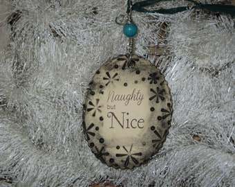 Handmade Ceramic Ornament - Naughty but Nice