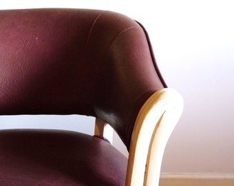 Burgundy and white rolling arm chair