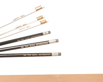 engraved pencils: white pencils, black pencils, happy mail, too much information