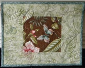 Quilted wall hanging: butterfly, leaves and flower extended into border (aka Ghost Quilting)