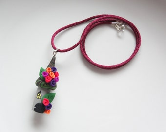 Witch house Halloween necklace in pink, purple and orange handmade from polymer clay