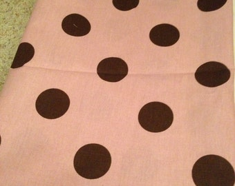 Pink with brown polka dots home decor weight fabric.